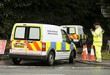 Police forensic vans arrive at the scene of an aircraft crash in Tarpoley, Cheshire